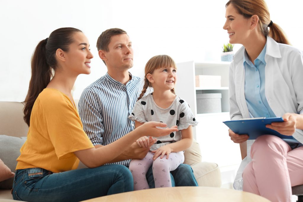 a young family speaking with a family medicine doctor