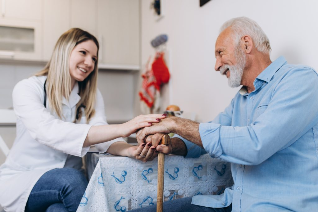 an elderly man talking with his house care provider