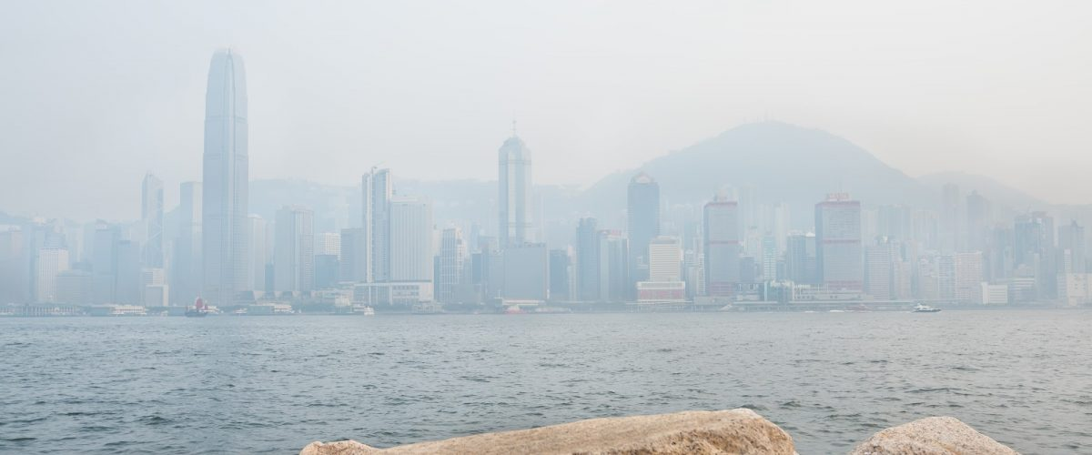 The skyscrapers of Hong Kong's financial district and Victoria Peak obscured by air pollution