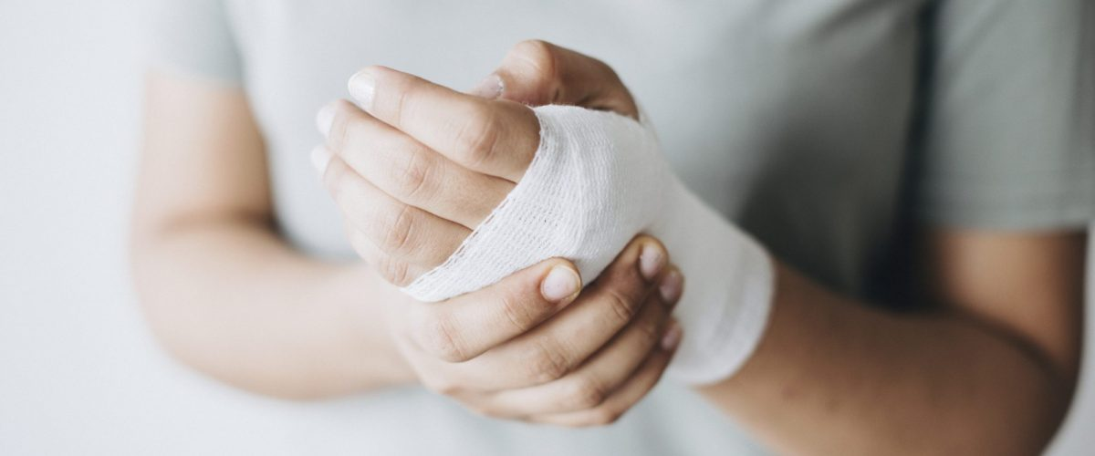 Woman with gauze bandage wrapped around her hand